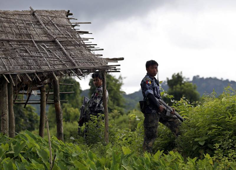 epa06399517 (FILE) - Myanmar police officers stand guard at Yebawkya village of Maungdaw township in Rakhine State, western Myanmar, 27 September 2017 (reissued 20 December 2017). Myanmar said it found 10 bodies buried in a mass grave in a village in northern Rakhine state on 20 December 2017, a day after the military launched an investigation in the area. More than 646,000 Rohingya refugees have crossed the border from Myanmar into Bangladesh, following the Myanmar army's 25 August crackdown on Rohingya rebels in the state of Rakhine.  EPA/NYEIN CHAN NAING