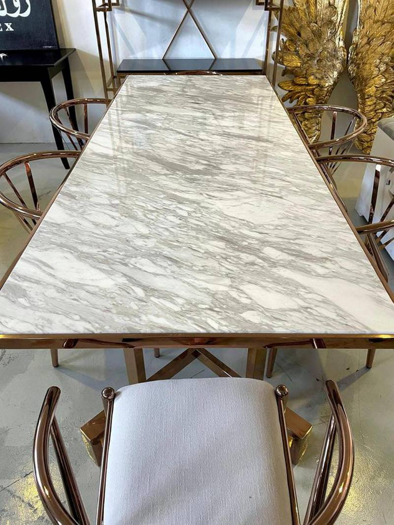 A second-hand marble dining table, with chairs from Kare, Dh5,000, at La Brocante.
