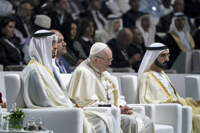 ABU DHABI, UNITED ARAB EMIRATES - February 4, 2019: Day two of the UAE papal visit - (L-R) HH Sheikh Mohamed bin Zayed Al Nahyan, Crown Prince of Abu Dhabi and Deputy Supreme Commander of the UAE Armed Forces, His Holiness Pope Francis, Head of the Catholic Church and HH Sheikh Mohamed bin Rashid Al Maktoum, Vice-President, Prime Minister of the UAE, Ruler of Dubai and Minister of Defence, attend the Human Fraternity Meeting, at The Founders Memorial. ( Rashed Al Mansoori / Ministry of Presidential Affairs ) ---