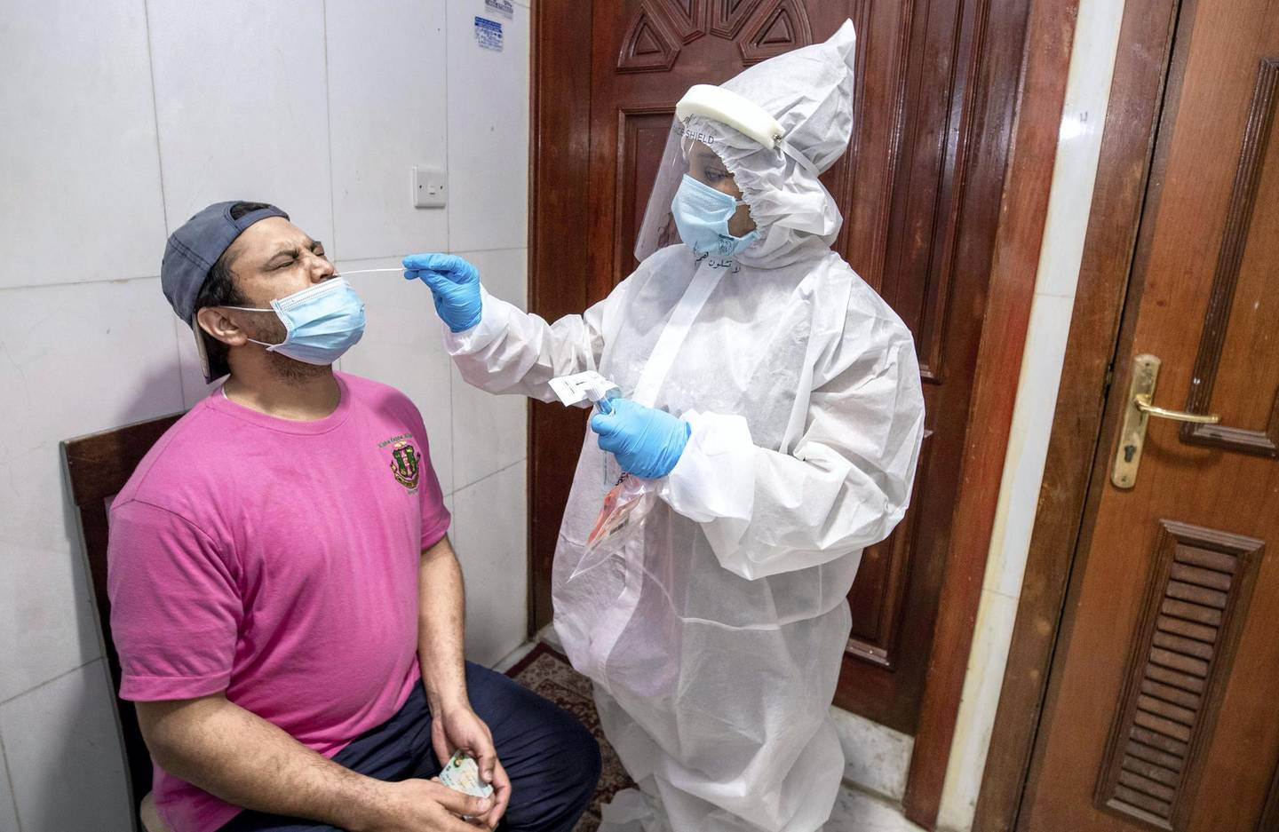 Abu Dhabi, United Arab Emirates, June 22, 2020.   STORY BRIEF: Police patrols knocking on doors offering free Covid-19 tests to residents in buildings in AD downtown, Al Bakra Street area.--  A resident gets tested.Victor Besa  / The NationalSection:  NAReporter:  Haneen Dajani