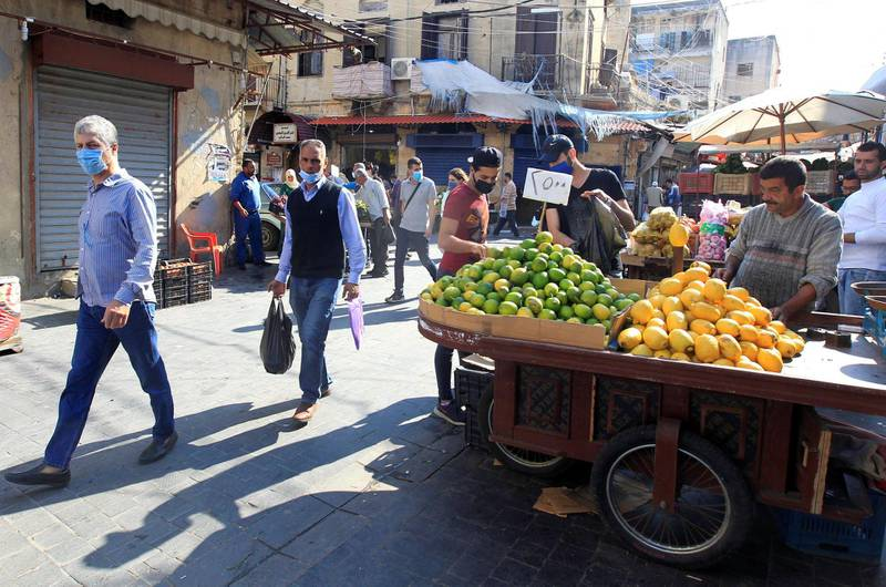 People walk at a souk, as the Lebanese government ordered a national lockdown, to combat a resurgence of the coronavirus disease (COVID-19) outbreak, in Sidon, Lebanon November 16, 2020. Picture taken November 16, 2020. REUTERS/Aziz Taher