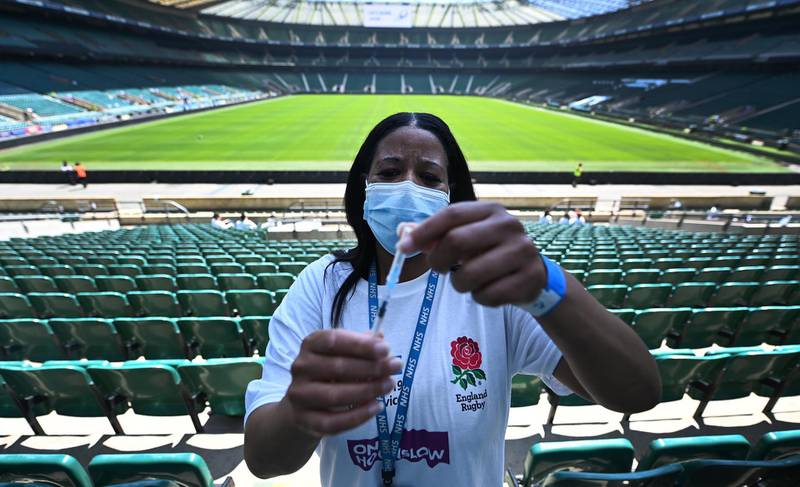 epa09238948 Covid vaccination staff with a Pfizer jab at Twickenham rugby stadium in London, Britain, 31 May 2021. The UK government is pushing ahead with its vaccination program in its fight against the Indian variant. Twickenham rugby stadium has become a mass vaccination centre offering first jabs to everyone over thirty years of age. The UK government plans to lift lockdown restrictions completely 21 June.  EPA/ANDY RAIN