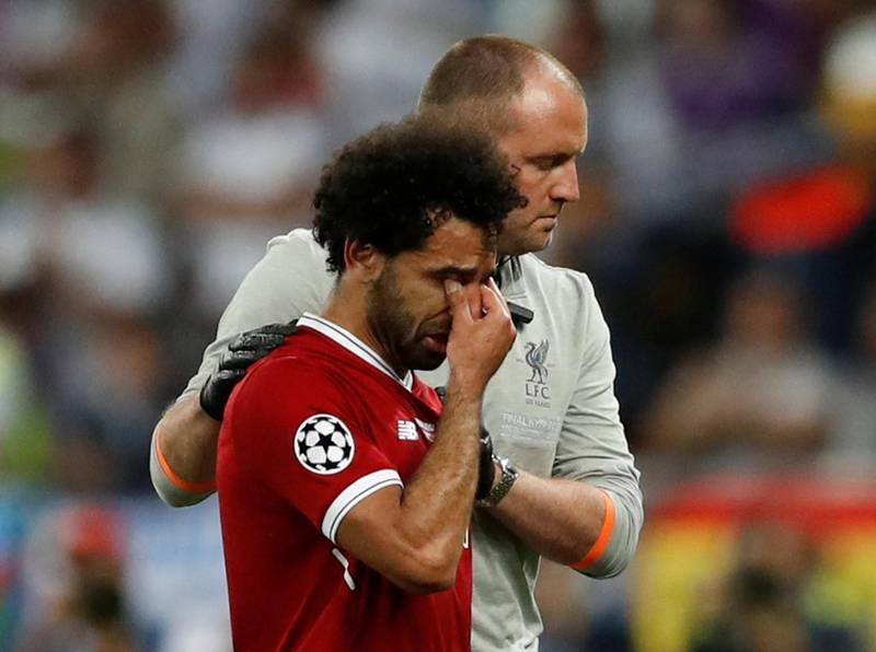 Soccer Football - Champions League Final - Real Madrid v Liverpool - NSC Olympic Stadium, Kiev, Ukraine - May 26, 2018   Liverpool's Mohamed Salah looks dejected as he is substituted off due to injury   REUTERS/Andrew Boyers