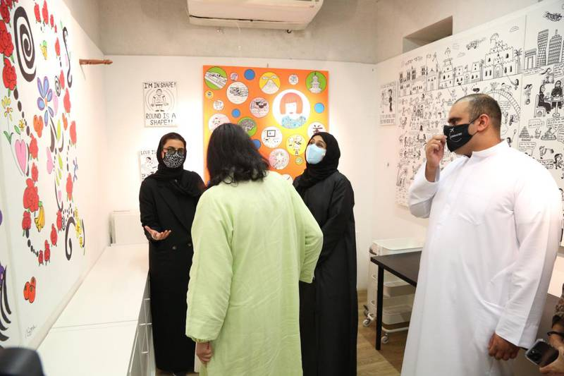 Noura Al Kaabi, the Minister of Culture and Youth and Hessa Buhumaid, the Minister of Community Development, are shown around a studio space by Emirati artists Abdullah Lutfi and Asma Baker who found a new place to work at Tashkeel in Dubai's Al Fahidi historical district. Courtesy: Next Chapter