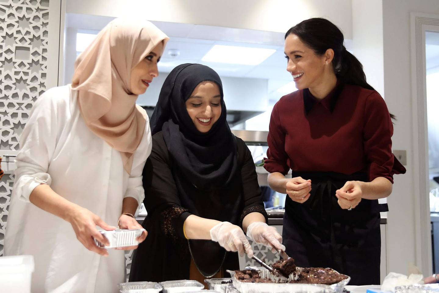 Britain's Meghan, Duchess of Sussex visits the Hubb Community Kitchen to see how funds raised by the 'Together: Our Community' cookbook are making a difference at Al Manaar, in London, Britain, November 21, 2018. Chris Jackson/Pool via REUTERS