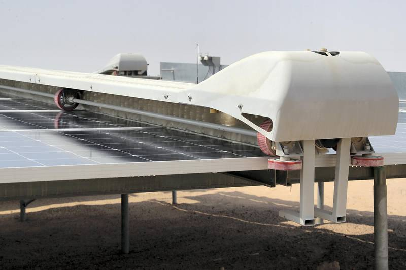 ABU DHABI,  UNITED ARAB EMIRATES , OCTOBER 1 – 2019 :- Robot cleaner cleaning the solar panels at the Noor Solar Power Plant in Sweihan in Abu Dhabi. ( Pawan Singh / The National ) For News. Story by Daniel