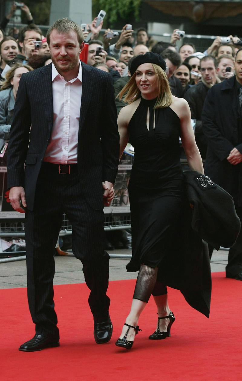 """LONDON - MAY 23: Madonna and Guy Ritchie arrive at the UK Premiere of """"Sin City"""" at the Empire Leicester Square on May 23, 2005 in London, England. (Photo by Jo Hale/Getty Images)"""