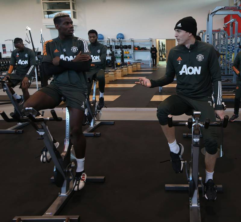 MANCHESTER, ENGLAND - NOVEMBER 19: (EXCLUSIVE COVERAGE) Paul Pogba and Victor Lindelof of Manchester United in action during a first team training session at Aon Training Complex on November 19, 2020 in Manchester, England. (Photo by Matthew Peters/Manchester United via Getty Images)