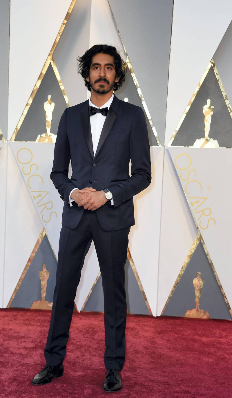 Actor Dev Patel arrives on the red carpet for the 88th Oscars on February 28, 2016 in Hollywood, California. AFP PHOTO / VALERIE MACON (Photo by VALERIE MACON / AFP)