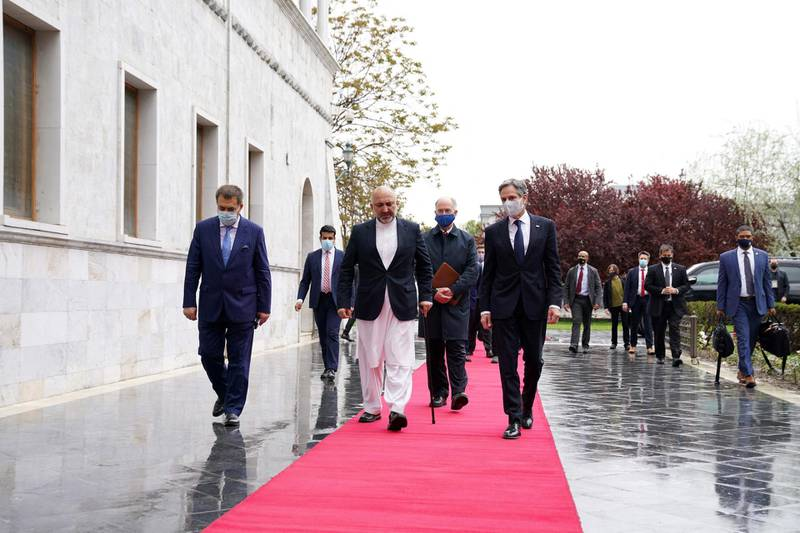 """CORRECTION / In this handout photograph taken on April 15, 2021 and released by Afghan Presidential Palace shows US Secretary of State Antony Blinken (center R) walks with Afghanistan's Minister of Foreign Affairs Mohammad Hanif Atmar (center L), in Kabul.  RESTRICTED TO EDITORIAL USE - MANDATORY CREDIT """"AFP PHOTO / Afghan Presidential Palace """" - NO MARKETING - NO ADVERTISING CAMPAIGNS - DISTRIBUTED AS A SERVICE TO CLIENTS  / AFP / Afghan Presidential Palace / - / RESTRICTED TO EDITORIAL USE - MANDATORY CREDIT """"AFP PHOTO / Afghan Presidential Palace """" - NO MARKETING - NO ADVERTISING CAMPAIGNS - DISTRIBUTED AS A SERVICE TO CLIENTS"""