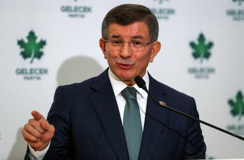 """Former Turkish prime minister and """"Future Party"""" chairman Ahmet Davutoglu gives a press conference after his party's meeting in Ankara on December 19, 2019. - Davutoglu, who served as prime minister between 2014 to 2016 and chairman of Erdogan's ruling party, formally presented the Future Party (""""Gelecek Partisi"""" in Turkish) at a ceremony in Ankara. (Photo by Adem ALTAN / AFP)"""