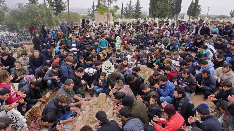 Mourners attend the funeral of Raed Fares and Hammoud al-Jneid in the village of Kafranbel in the northwestern province of Idlib on November 23, 2018. / AFP / Muhammad HAJ KADOUR
