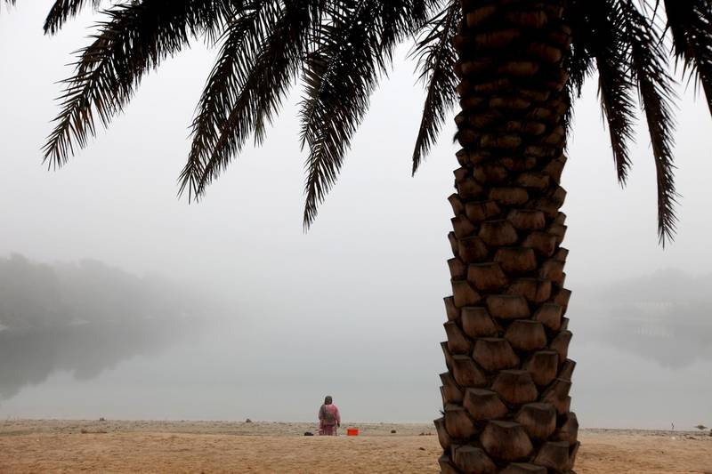 January 9, 2011 / Abu Dhabi / (Rich-Joseph Facun / The National) Despite heavy fog throughout Abu Dhabu today, a woman spends the morning along the shore, Sunday, January 9, 2011 in Abu Dhabi.