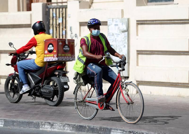 Dubai, United Arab Emirates - Reporter: N/A. News. Coronavirus/Covid-19. A man on a bike wears a mask to curb the spread of the coronavirus in Satwa, Dubai. Tuesday, October 20th, 2020. Dubai. Chris Whiteoak / The National
