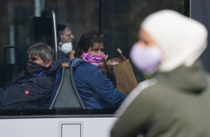 LEIPZIG, GERMANY - APRIL 20: People wearing protective face masks ride a street tram on the first day face masks became compulsory on public transport in the state of Saxony during the novel coronavirus crisis on April 20, 2020 in Leipzig, Germany. Germany is taking its first steps to ease restrictions on public life that had been imposed weeks ago in order to stem the spread of the coronavirus. Shops across the country are reopening, factory assembly lines are restarting and high schools are holding final exams. Health leaders are monitoring the process carefully for any resurgence of coronavirus infections. The number of infections nationwide is still rising, though so far at a declining rate. (Photo by Sean Gallup/Getty Images)