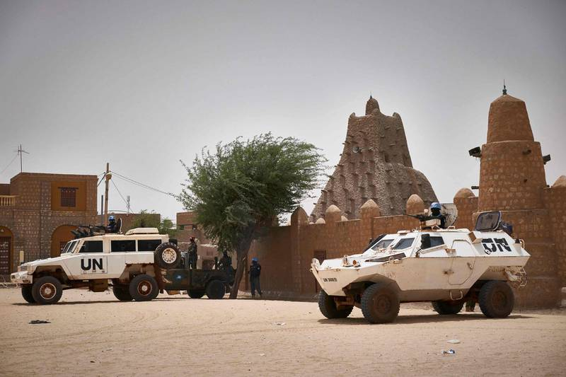 """United Nations vehicles patrol in front of the mosque Sankore in Tombouctou on March 31, 2021. A symbolic euro was handed over to the government of Mali and UNESCO for damage inflicted by Islamists who wrecked Timbuktu's World Heritage-listed mausoleums in 2012. Fatou Bensouda, the ICC's chief prosecutor, said the case represented the international community's commitment to """"defend the foundation of our common identity."""" / AFP / MICHELE CATTANI"""