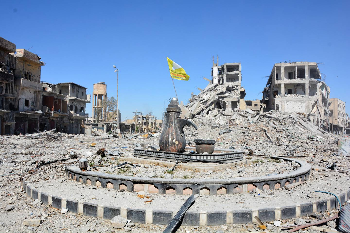 epaselect epa06274744 A view of the Al-Na'im roundabout after its liberation in central Al-Raqqa, Syria, 18 October 2017 (issued 19 October 2017). The Al-Na'im roundabout also known as the 'Roundabout of Hell', located in the center of the city of Al-Raqqa, has been the last to be liberated by US backed Syrian forces from the grip of the organization of the so-called Islamic State (IS, ISIS or ISIL). The roundabout was used by ISIS extremists to perform public executions, beheadings and crucifixions during their three-year rule of the city.  EPA/YOUSSEF RABIH YOUSSEF