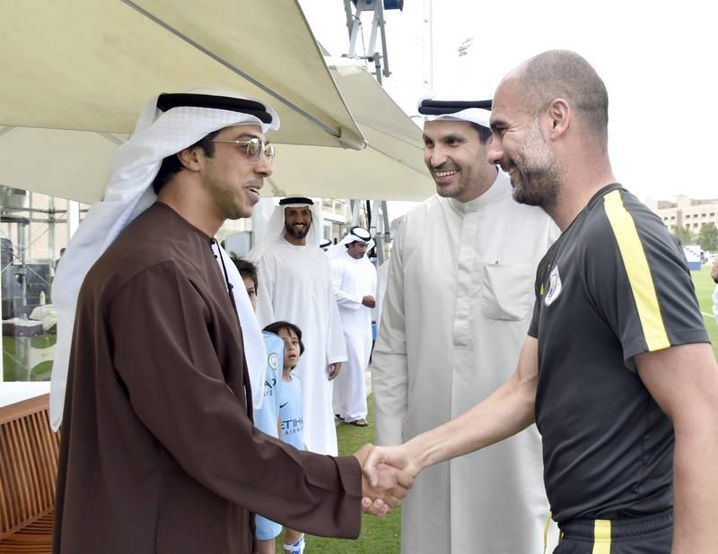 منصور بن زايد /نادي مانشستر سيتي.  H.H. Sheikh Mansour bin Zayed Al Nahyan, Deputy Prime Minister and Minister of Presidential Affairs and owner of Manchester City Football Club, meets Pep Guardiola in Abu Dhabi. Shown here withKhaldoon Khalifa Al Mubarak (centre)  (WAM) *** Local Caption ***  7fb21591-c3a8-4588-b24e-5d51e2eb47f6.JPG sp01mr-football-manchester.jpg