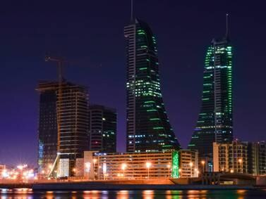 Bahrain landmarks lit up in Saudi flag colours - in pictures