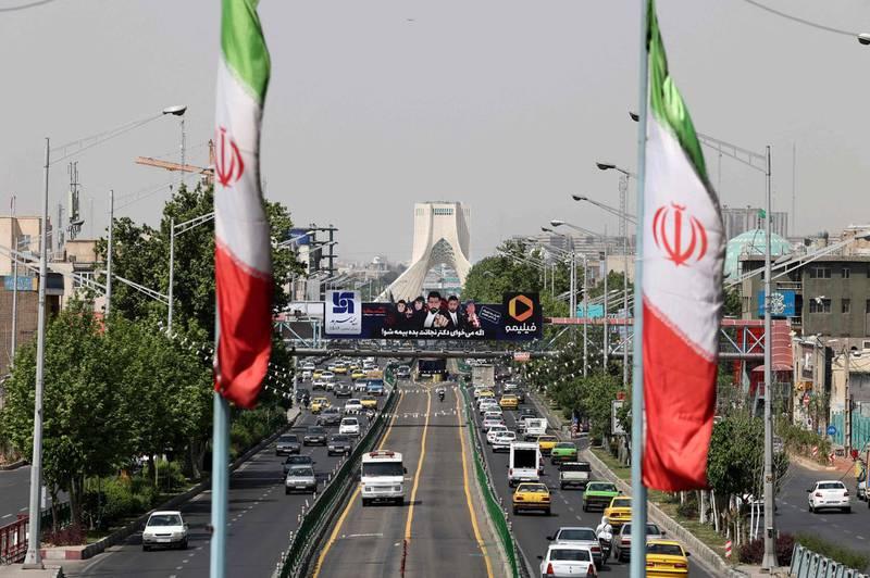 A view shows traffic on Azadi street in Iran's capital Tehran on April 20, 2021. / AFP / ATTA KENARE