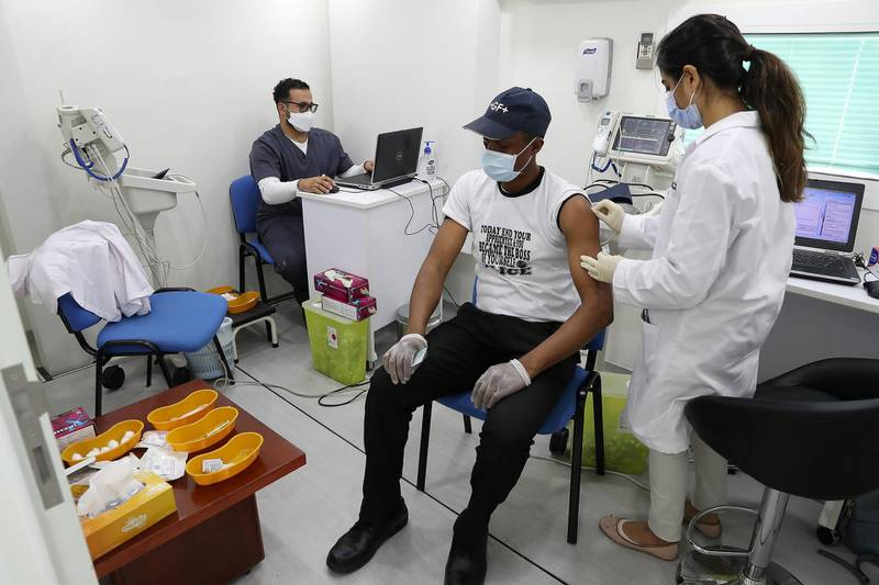 DUBAI, UNITED ARAB EMIRATES , March 11, 2021 – People getting their Covid vaccine at the  MBRU a community mobile health clinic near the Al Waha Community on Nad Al Hamar Road in Dubai. (Pawan Singh / The National) For News/Online/Instagram. Story by Nick Webster