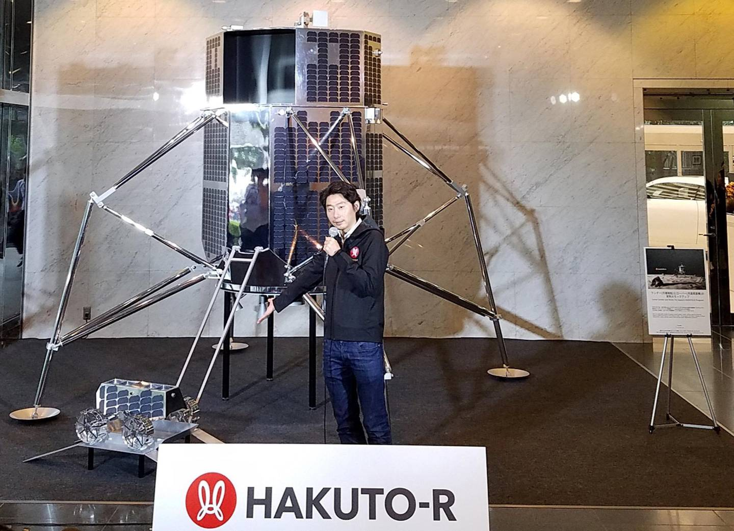 Takeshi Hakamada, CEO of Japanese firm ispace, holds a press conference to explain about the ipsace lunar lander and rover of its lunar programme HAKUTO-R in Tokyo on September 26, 2018. - A Japanese start-up said on September 26 it has signed with Elon Musk's SpaceX for two exploration projects to send spacecraft to the moon. Japan's ispace, a private lunar exploration company, will send its lunar lander and rovers in mid-2020 and mid-2021 on a SpaceX's rocket. (Photo by Natsuko FUKUE / AFP)