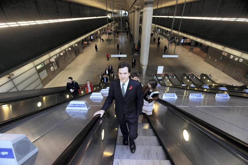 """LONDON, ENGLAND - OCTOBER 26:  Shadow Chancellor of the Exchequer George Osborne arrives at Canary Wharf tube station to deliver a speech urging banks to cap staff bonuses on October 26, 2009 in London, England. Mr Osborne called for a 2,000 GBP limit on the amount high-street banks should be able to pay in cash bonuses with larger bonuses being paid in company shares. The Tory proposals were dismissed by rival political parties as """"stop-gap solutions designed to stem public anger but which fail to get to the heart of the problem"""".  (Photo by Oli Scarff/Getty Images)"""