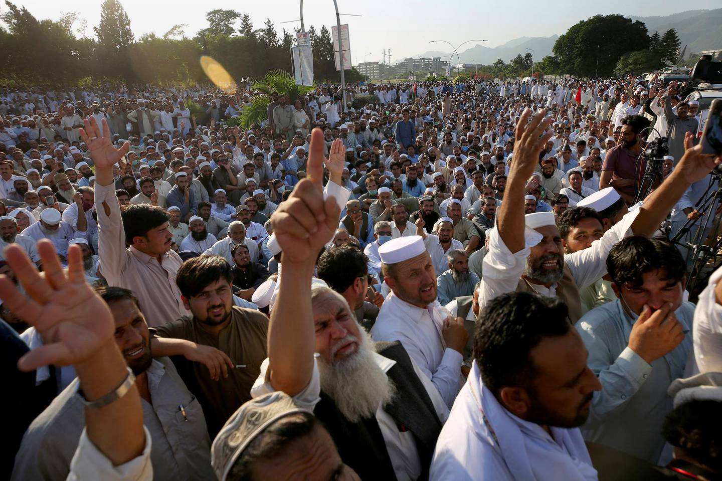 Thousands of government employees stage a sit-in protest in front of the parliament building demanding job regularization, increases in their salaries and other benefits, in Islamabad, Pakistan, Tuesday, Oct. 6, 2020. (AP Photo/Anjum Naveed)