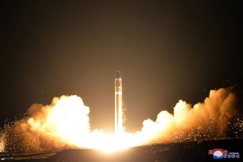 """This Wednesday, Nov. 29, 2017, image provided by the North Korean government on Thursday, Nov. 30, 2017, shows what the North Korean government calls the Hwasong-15 intercontinental ballistic missile, at an undisclosed location in North Korea. Independent journalists were not given access to cover the event depicted in this image distributed by the North Korean government. The content of this image is as provided and cannot be independently verified. Korean language watermark on image as provided by source reads: """"KCNA"""" which is the abbreviation for Korean Central News Agency. (Korean Central News Agency/Korea News Service via AP)"""
