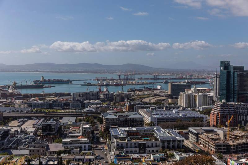 The port area stands beyond commercial high-rise properties in Cape Town, South Africa, on Wednesday, Aug. 19, 2020. The country, which in late March implemented one of the world's strictest lockdowns to curb the spread of Covid-19, moved to a so-called alert level 2 on Monday, enabling most restricted economic activity to resume. Photographer: Dwayne Senior/Bloomberg