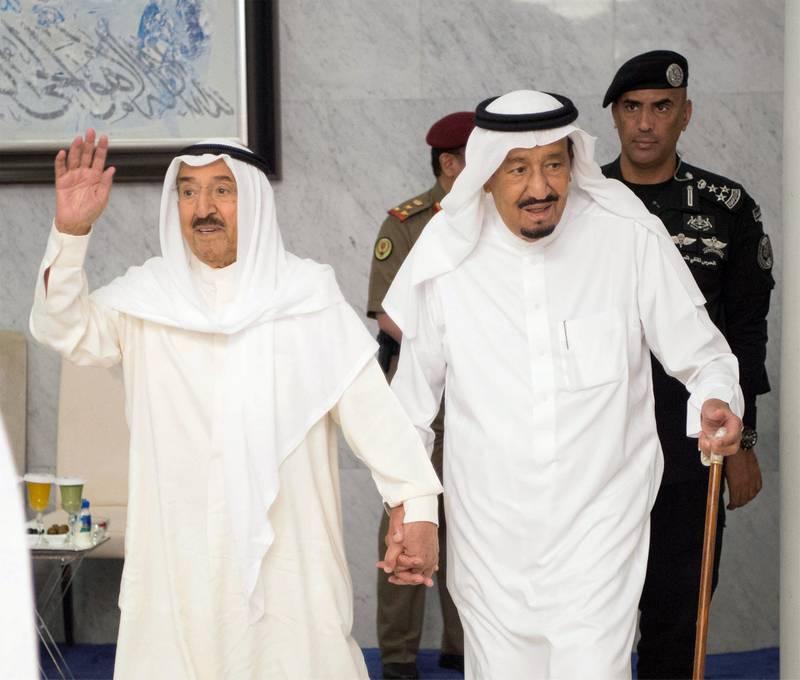 Saudi Arabia's King Salman bin Abdulaziz Al Saud (R) holds hands with Emir of Kuwait Sabah Al-Ahmad Al-Jaber Al-Sabah in Jeddah, Saudi Arabia, June 6, 2017. Bandar Algaloud/Courtesy of Saudi Royal Court/Handout via REUTERS ATTENTION EDITORS - THIS PICTURE WAS PROVIDED BY A THIRD PARTY. FOR EDITORIAL USE ONLY.