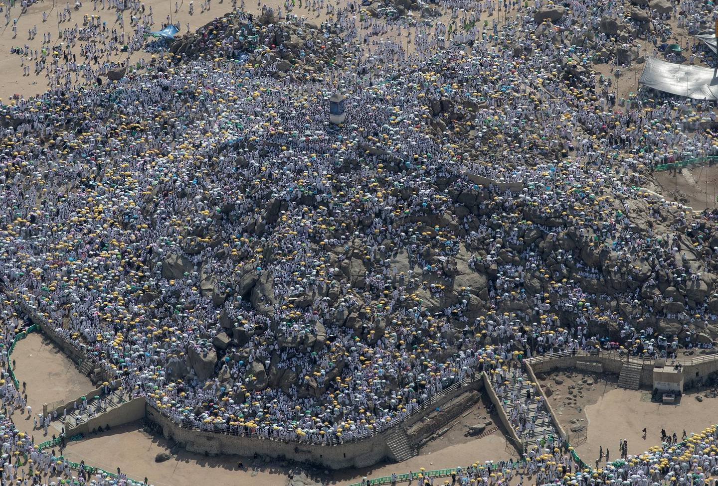 epaselect epa06959727 An aerial view of the Mount Arafat, where thousands Muslim worshippers gather during the Hajj pilgrimage, near Mecca, Saudi Arabia, 20 August 2018. Around 2.5 million Muslims are expected to attend this year's Hajj pilgrimage, which is highlighted by the Day of Arafah, one day prior to Eid al-Adha. Eid al-Adha is the holiest of the two Muslims holidays celebrated each year, it marks the yearly Muslim pilgrimage (Hajj) to visit Mecca, the holiest place in Islam.  EPA/SEDAT SUNA