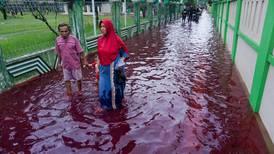 Streets run red as floods hit Indonesian batik-manufacturing hub