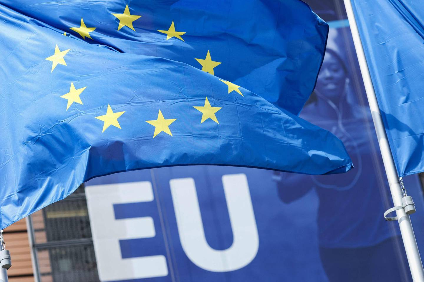 A picture taken on may 5, 2021 shows a flag of the European Union flying outside the European commission headquarters in Brussels.  / AFP / Kenzo TRIBOUILLARD