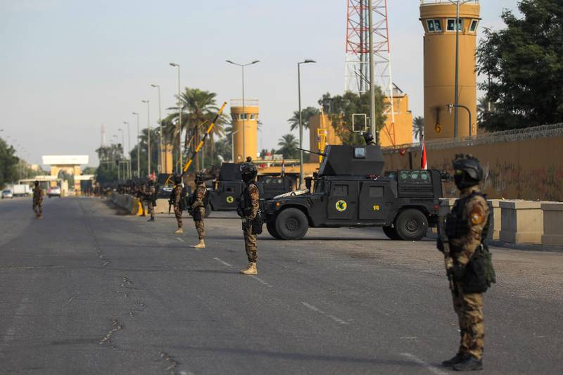 (FILES) In this file photo taken on January 02, 2020 Iraqi counter-terrorism forces stand guard in front of the US embassy in the capital Baghdad after hundreds of men stormed the high-security Green Zone and besieged the US compound. As Iraqi Prime Mininister Mustafa al-Kadhemi prepares for his first meeting with US President Donald Trump this week, attacks on American targets by pro-Iranian fighters have been on the rise. With Tehran and Washington competing for influence in Iraq, the gulf between pro-Iranian factions and the US-friendly premier Kadhemi is growing.  / AFP / AHMAD AL-RUBAYE