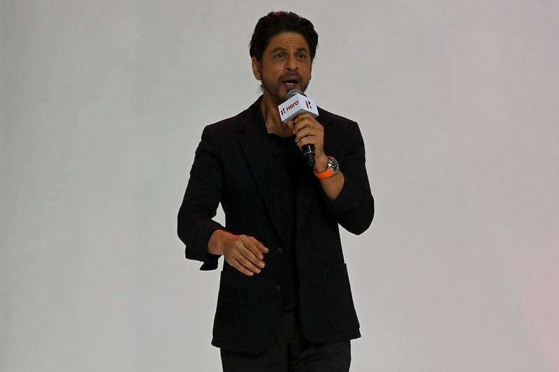 Bollywood actor Shah Rukh Khan speaks during the unveiling of the company's 100 millionth motorcycle, in Gurgaon on January 21, 2021. (Photo by Money SHARMA / AFP)
