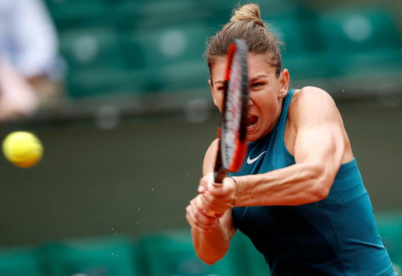 epa06772743 Simona Halep of Romania in action against Alison Riske of the USA during their women's first round match during the French Open tennis tournament at Roland Garros in Paris, France, 30 May 2018.  EPA/YOAN VALAT