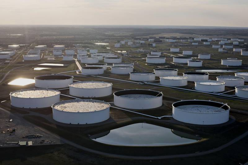 Oil storage tanks stand in this aerial photograph taken above Cushing, Oklahoma, U.S., on Tuesday, March 24, 2015. The fastest oil-inventory growth on record at the main U.S. hub may be about to end, easing concern that storage limits will be strained. Photographer: Daniel Acker/Bloomberg