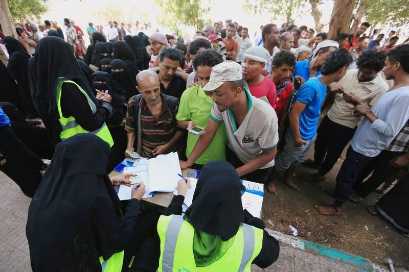 FILE PHOTO: People gather at a United Nations aid distribution center in Hodeidah, Yemen November 13, 2018.  Picture taken November 13, 2018. REUTERS/Abduljabbar Zeyad/File Photo