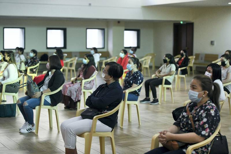 Abu Dhabi, United Arab Emirates - Worshippers follow guidelines and social distance during Christmas mass at Bishop Paul Hinder Jubilee Memorial Parish Hall in St. JosephÕs Cathedral, in Mushrif. Khushnum Bhandari for The National