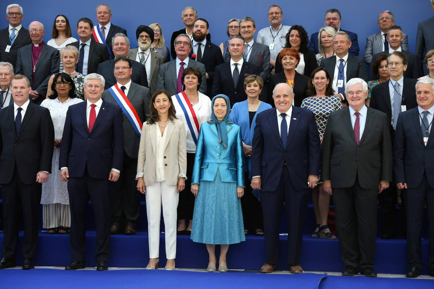 """(L-R, front row) Canadian foreign minister John Baird, Canadian retired politician Stephen Joseph, Colombian-French politician and former senator Ingrid Betancourt, leader of the People's Mujahedin of Iran Maryam Rajavi, former US mayor of New York City and attorney to President Donald Trump Rudolph Giuliani, former US Speaker of the House Newt Gingrich,  US author and Chairman of the Center for Equal Opportunity Linda Chavez (2nd row, 3rd R),  Italy's former Foreign Affairs Minister Giulio Terzi di Sant'Agata (2nd row, R) pose for a picture during the meeting """"Free Iran 2018 - the Alternative"""", organised by the People's Mujahedin of Iran in Villepinte, near Paris on June 30, 2018. (Photo by Zakaria ABDELKAFI / AFP)"""