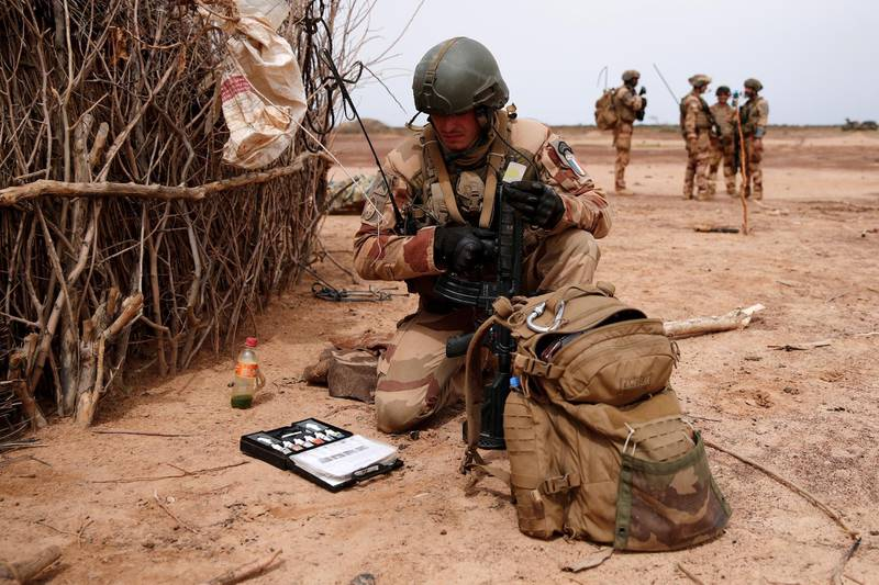 FILE PHOTO: A French soldier of the 2nd Foreign Engineer Regiment uses an explosive detection kit in the Gourma region during Operation Barkhane in Ndaki, Mali, July 28, 2019. REUTERS/Benoit Tessier/File Photo