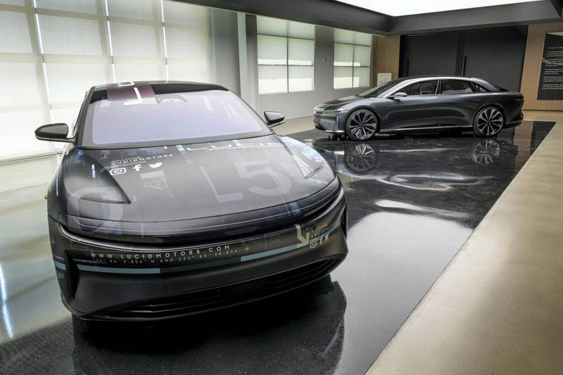 Lucid Air prototype electric vehicles, manufactured by Lucid Motors Inc., are displayed at the company's headquarters in Newark, California, U.S., on Monday, Aug. 3, 2020. The final specs and design of the Lucid Air are due to be unveiled at an event in September and executives say customers can now expect delivery of the first batch of Airs in spring 2021. Photographer: David Paul Morris/Bloomberg