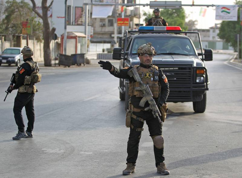 A picture taken on September 25, 2017 shows members of SWAT (Special Weapons and Tactics) security forces, affiliated to the Iraqi Interior Ministry, deploying in the streets of the northern city of Kirkuk during the vote on the Kurdish independence on September 25, 2017. The non-binding vote, initiated by veteran Kurdish leader Massud Barzani, has angered not only Baghdad, following which Iraq's federal parliament demanded that troops be sent to disputed areas in the north controlled by the Kurds since 2003, but also neighbours Turkey and Iran who are concerned it could stoke separatist aspirations among their own sizeable Kurdish minorities. / AFP PHOTO / AHMAD AL-RUBAYE