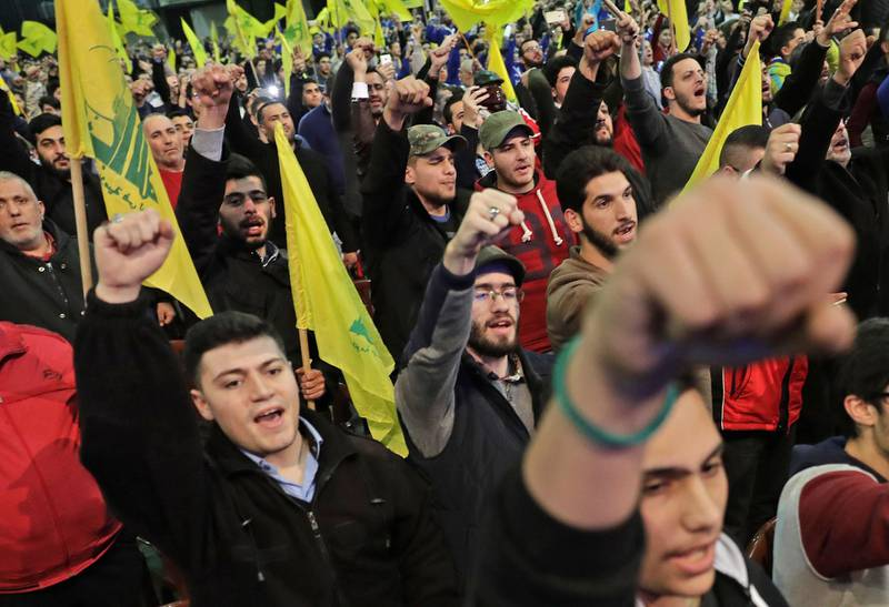 Supporters of Lebanese Hezbollah Leader gather as he delivers a televised speech during a ceremony held by the Shiite party in the capital Beirut, commemorating the party's killed leaders, on February 16, 2018. / AFP PHOTO / JOSEPH EID