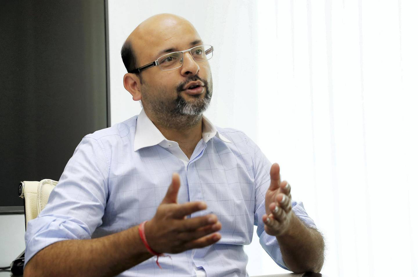 DUBAI , UNITED ARAB EMIRATES , April 15 – 2019 :- Vaibhav Doshi Founder and CEO of RentSher Middle East, a Dubai based online platform for rentals of products and services during the interview at his office in the Tiffany Tower in JLT in Dubai. ( Pawan Singh / The National ) For Business. Story by Nada El Sawy