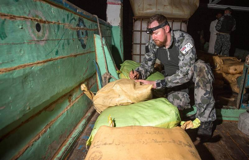 Petty Officer Electronics Technician Leslie Floyd numbers parcels of seized narcotics as HMAS Warramunga's boarding team conduct an illicit cargo seizure. Courtesy Commonwealth of Australia *** Local Caption *** HMAS Warramunga intercepted and boarded a suspect vessel in international waters in the Arabian Sea on 03 January 2018 around 0830 (AEDT) with the support of a UK Royal Navy helicopter, seizing more than 3.5 tonnes of hashish, estimated to be valued at more than AUD$180 million. The operation was planned by the Combined Maritime Forces' (CMF) Combined Task Force 150 (CTF-150) which is commanded by Australia and supported by a combined Australian-Canadian staff.  Warramunga is deployed on Operation MANITOU, supporting international efforts to promote maritime security, stability and prosperity in the Middle East region (MER).    Warramunga routinely supports CMF operations. The CMF is a 32-nation partnership focused on defeating terrorism, preventing piracy, encouraging regional cooperation and promoting a safe maritime environment.  Warramunga is on her third deployment to the MER and is the 66th rotation of a Royal Australian Navy vessel to the region since 1990.