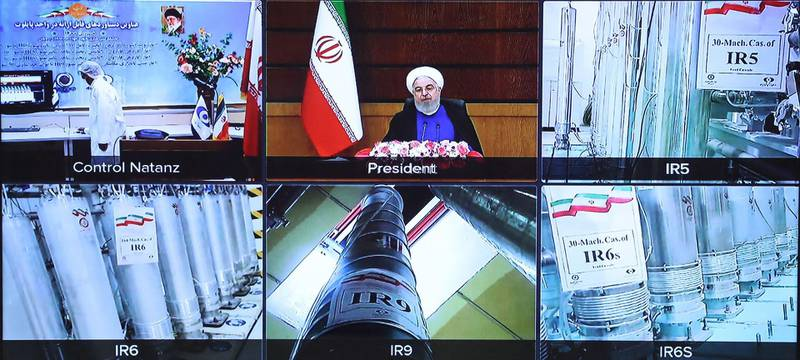 """TOPSHOT - A handout picture provided by the Iranian presidential office on April 10, 2021, shows a screen grab from a videoconference showing views of centrifuges and devices at Iran's Natanz uranium enrichment plant, as well as Iranian President Hassan Rouhani delivering a speech, on Iran's National Nuclear Technology Day, in the capital Tehran. Iran announced today it has started up advanced uranium enrichment centrifuges in a breach of its undertakings under a troubled 2015 nuclear deal, days after talks on rescuing it got underway. President Hassan Rouhani officially inaugurated the cascades of 164 IR-6 centrifuges and 30 IR-5 devices at Iran's Natanz uranium enrichment plant in a ceremony broadcast by state television.  - === RESTRICTED TO EDITORIAL USE - MANDATORY CREDIT """"AFP PHOTO / HO / IRANIAN PRESIDENCY"""" - NO MARKETING NO ADVERTISING CAMPAIGNS - DISTRIBUTED AS A SERVICE TO CLIENTS ===  / AFP / Iranian Presidency / - / === RESTRICTED TO EDITORIAL USE - MANDATORY CREDIT """"AFP PHOTO / HO / IRANIAN PRESIDENCY"""" - NO MARKETING NO ADVERTISING CAMPAIGNS - DISTRIBUTED AS A SERVICE TO CLIENTS ==="""