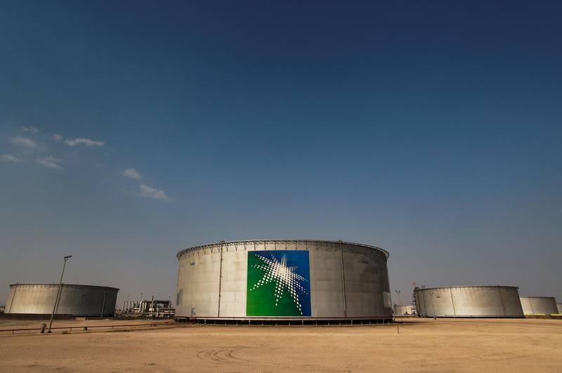 FILE PHOTO: A view shows branded oil tanks at Saudi Aramco oil facility in Abqaiq, Saudi Arabia October 12, 2019. REUTERS/Maxim Shemetov/File Photo
