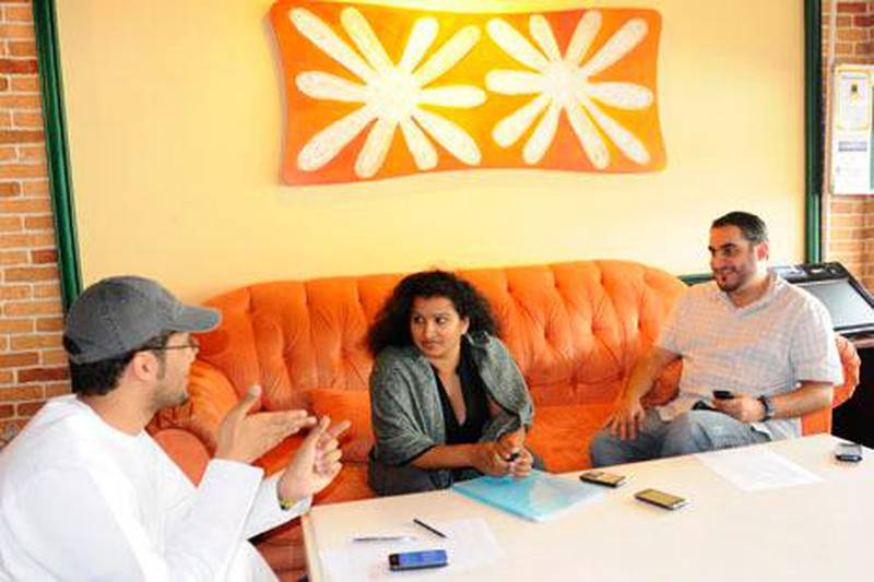 Saro Carlwig(C), founder/Agent of Talent Casting Agency(TCA), with two new writers, Ahmed Arshi(R) and Khaled Al Jabri(L),  she just signed up to TCA on Saturday, March 05, 2011 in Dubai, United Arab Emirates.  Photo: Charles Crowell for The National